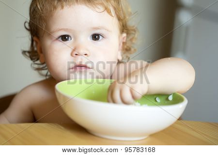 Portrait Of Small Baby Boy Eating