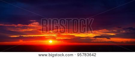 Red summer sunset sky panorama. Dark vibrant colors.