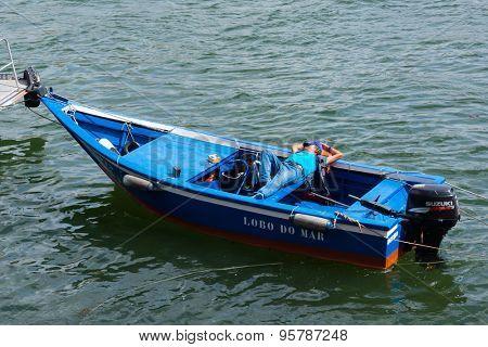 PORTO, PORTUGAL - JUNE 15, 2015: Unidentified man dreams on a rocking boat on June 15, 2015 in Porto, Portugal