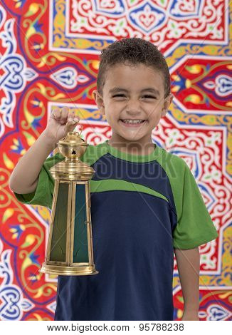 Adorable Smiling Young Boy With Ramadan Lantern