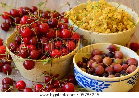 Cherries, currants and gooseberries in vintage bowls
