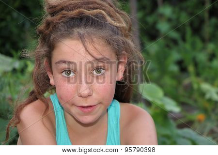 Ten Years Old Caucasian Girl Outdoors With Freckles