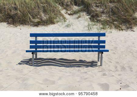 Blue Bench In Beach Sand