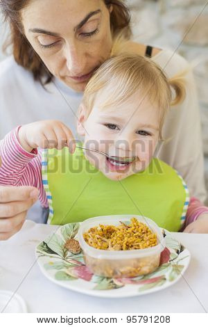 Baby Eating Rice From Tupperware