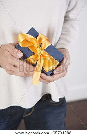 Hands Holding Blue Gift