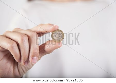 Woman Hand Showing Worn Euro Coin