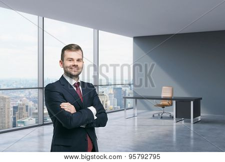 A Handsome Businessman In A Workplace At Modern Corner Panoramic Office In New York, Manhattan. A Co