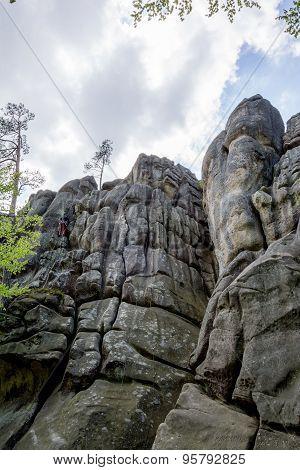 Male climber climbing rock