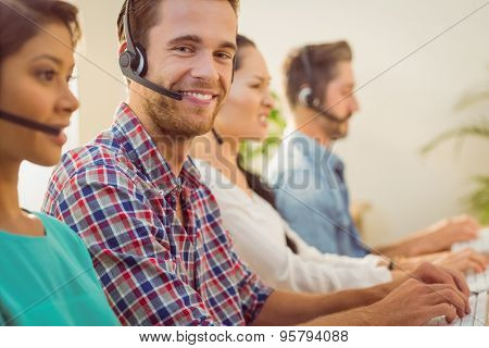 Close up portrait of a smiling businessman working in a call centre