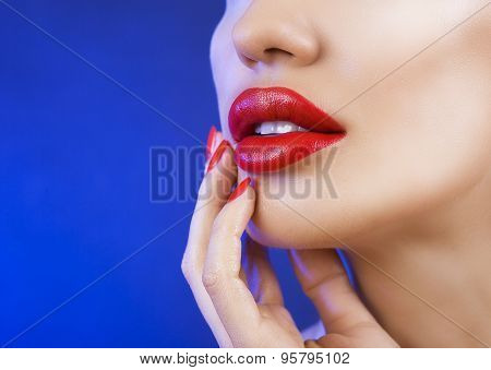 Beautiful Sexy Young Girl With Red Lips, Bright Make-up On Blue Background
