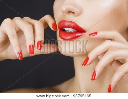 Beautiful Sexy Young Girl With Red Lips And Red Nail Polish, Bright Make-up On Dark Background