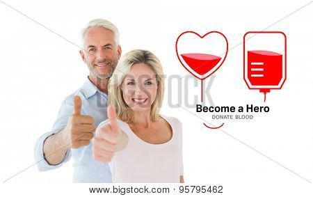 Smiling couple showing thumbs up together against blood donation