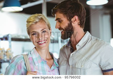 Portrait of a cute couple on a date looking at the camera