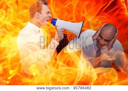Businessman yelling with a megaphone at his colleague against fire