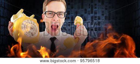 Geeky businessman shouting at retro phone against dark grey room