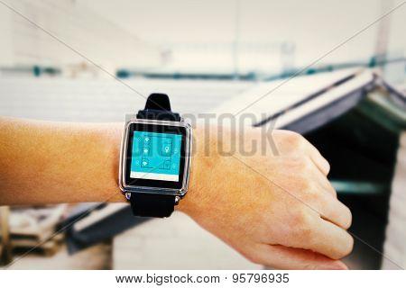 Smartwatch on wrist against workshop