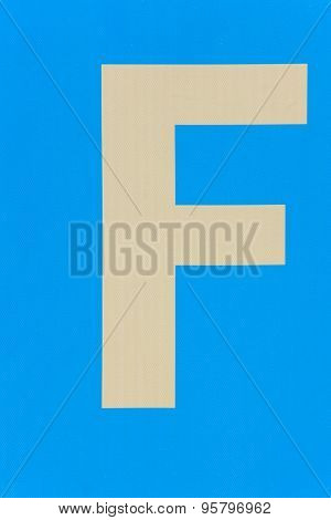 White Textured F Letter Over A Blue Background