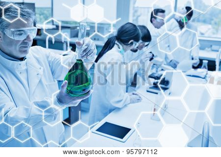 Science graphic against chemists working in a laboratory