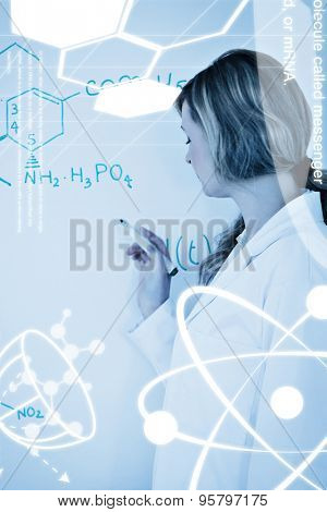 Science graphic against female scientist writing a formula on a whiteboard