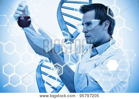 Science graphic against scientist looking at beaker of blood