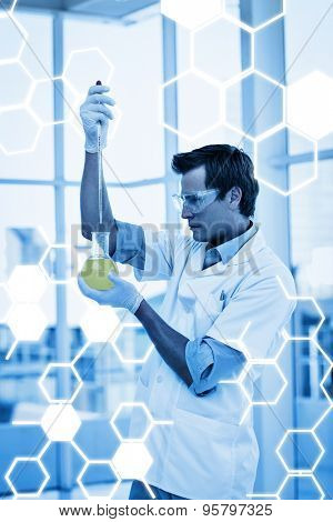 Science graphic against scientist examining a testtube