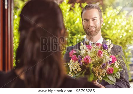 Handsome Guy Gives Fresh Flowers To His Girlfriend