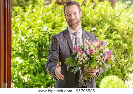 Businessman With Flowers Showing Handshake Gesture