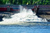 stock photo of dam  - Water power station seen letting out water from the dam to keep water at the right level above the station. ** Note: Visible grain at 100%, best at smaller sizes - JPG