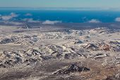 foto of iceland farm  - Aerial view of snowy mountains and agriculture during winter out of  the plan - JPG