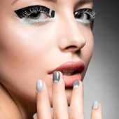 foto of nail-design  - Beautiful girl with bright creative fashion makeup and Grey nail polish - JPG