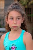 stock photo of ten years old  - Ten years old caucasian girl outdoors with freckles - JPG