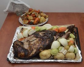 picture of shoulder-blade  - lamb shoulder blade and vegetables baked in the oven laid on the dish with foil - JPG