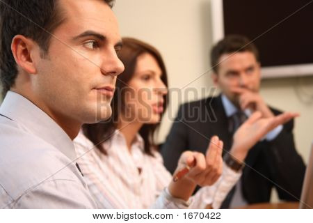 Group Of Business People At A Meeting - One Man In Focus