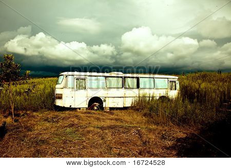 old destroyed bus and approaching storm