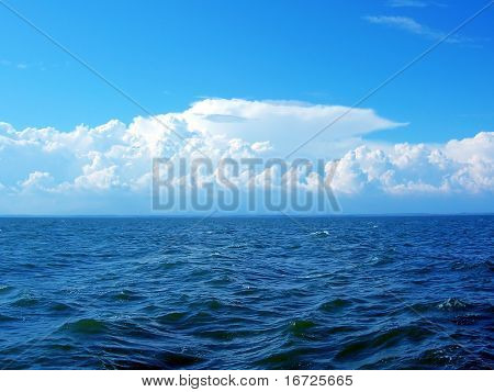 Blue sea and white sky.