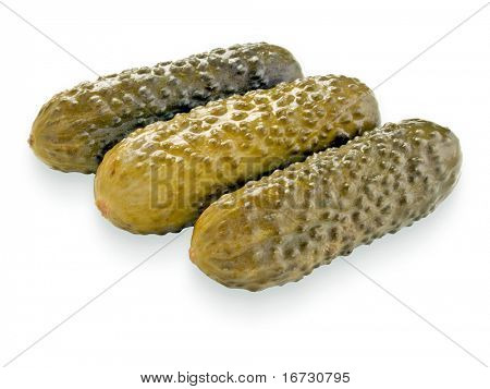 Salted cucumbers on white background (isolated).