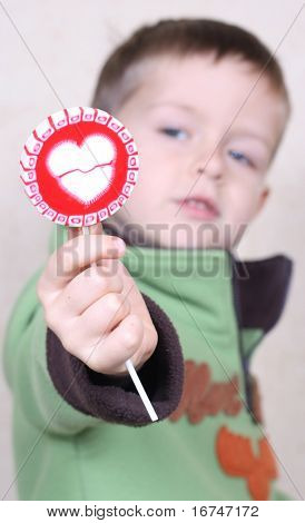 five years old boy with lollipop - I give you my heart :)