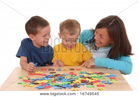 children and mother playing with letters isolated on white