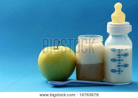 bottle of milk and jar of porridge - baby food