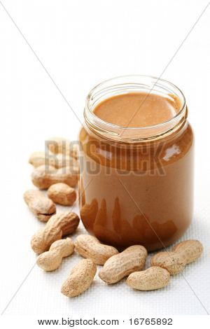 jar of peanut butter on white - food and drink