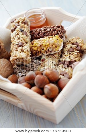 delicious and healthy granola bars with some nuts - diet and breakfast