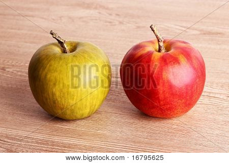 red and green apple on wooden table