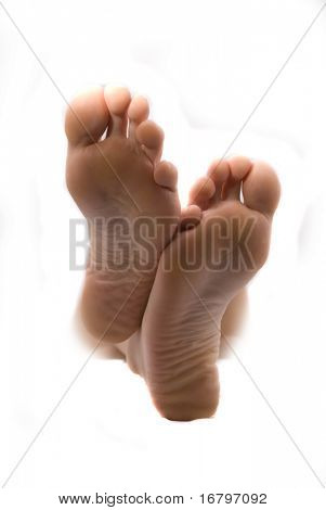 Beautiful woman feet. Isolated on white background