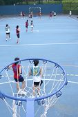 stock photo of netball  - Asian teen netball game from high viewpoint