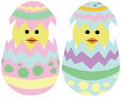 stock photo of easter_break  - Twin Easter chicks hatching from decorated eggs - JPG