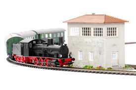 picture of loco  - old steam loco model with passenger cars isolated over white background - JPG