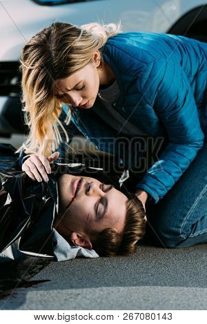 Young Woman Crying Above Dead
