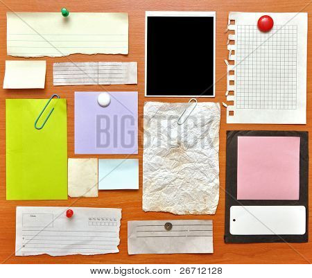 bulletin board with paper notes and old blank