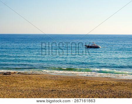 Boat Is Sailing Along Seashore