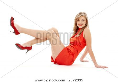 Sitting Girl In Red Dress With Legs Up